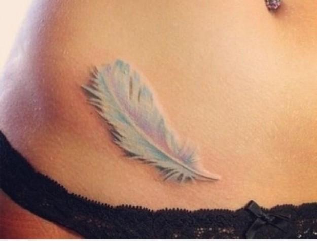 una-piuma-sensuale-white-ink-tattoo